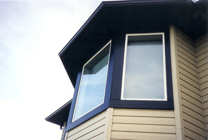 Calgary windows bay bow capping cladding custom for Window cladding